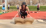 Falmouth's Jake Campbell competes int he long jump during the Sandwich vs. Falmouth track meet at Sandwich High School Wednesday afternoon.