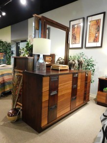 """Marquette Dresser and Marquette Mirror Wood Species Shown: Brown Maple / Ribbon Sapele Dimensions: 38.5""""H x 66""""W x 20.25""""D and 40.5""""H x 30""""W Price As Shown*: $2,852 and $425 Fully Customizable. *Price of piece is not inclusive of current sales. See our Pricing page for more details."""