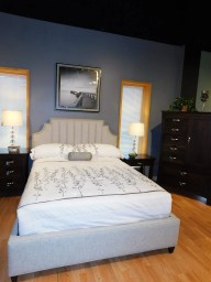 """Lindley Upholstered Bed 54""""H Fabric Shown: Pebble Nailhead: Pewter Feet: Espresso Size Shown: Queen Price As Shown*: $1,988 Fully Customizable. *Price of piece not inclusive of current sales. Please see our Pricing page for more details."""