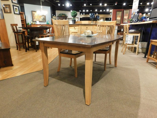 """Splayed Leg Table with 2 12"""" Self-Storing Leaves, Boat Shaped Top Without Inlay and with Eased Edge Wood Species Shown: Brown Maple Dimensions: 42""""W x 90""""L (open) Fully Customizable. Shown with LO-OW Shaker High-Backed Chairs. Please contact us for pricing details."""