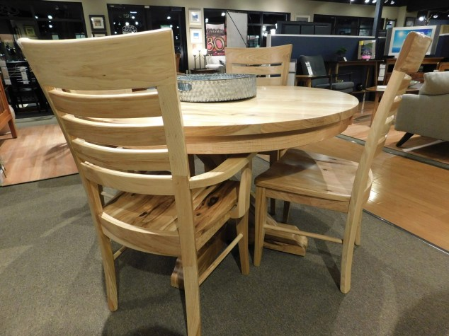 """Round Alberta Table with 2 12"""" Leaves, 1.25"""" Top, Eased Edge Wood Species Shown: Rustic Hickory Dimensions: 48"""" W x 72""""L (open) Fully Customizable. Shown with Metro Ladder Chairs. Please contact us for pricing details."""