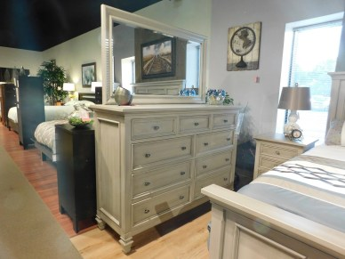 """Legacy Village Tall Dresser and Mirror Wood Species Shown: Brown Maple Dimensions: 61.75""""W x 43.75""""H x 20""""D and 53""""W x 31.5""""H Price As Shown*: $3,542 and $599 Fully Customizable. *Price of piece not inclusive of current sales. Please see our Pricing page for more details."""