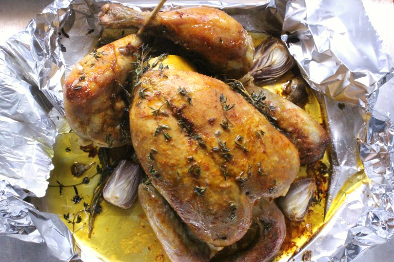 Whole roasted chicken with thyme and lemon