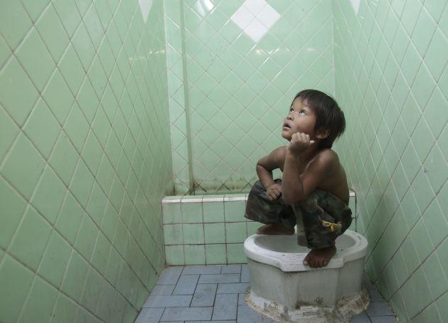 little boy on squat toilet