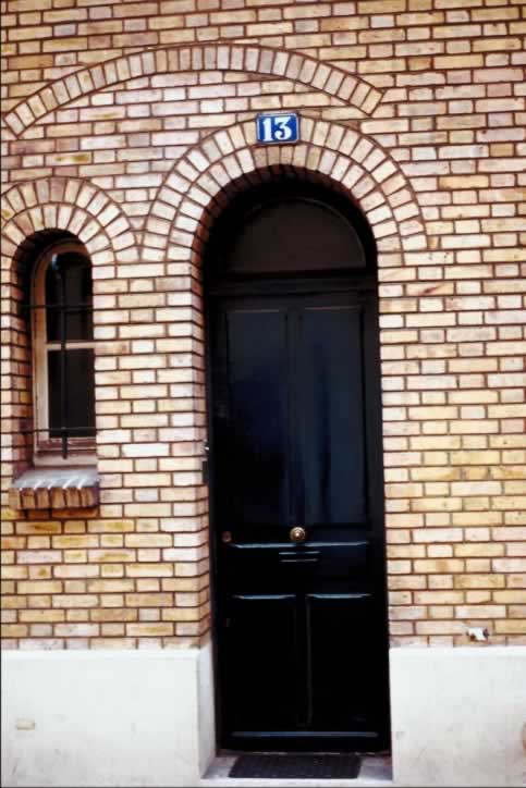 Glossy Black Double Exterior Doors With Fanlight Of Arrows