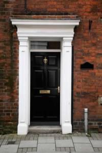 Black Exterior Door with White Columns and Entablature ...