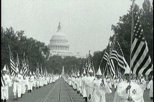 kkk-carrying-american-flag
