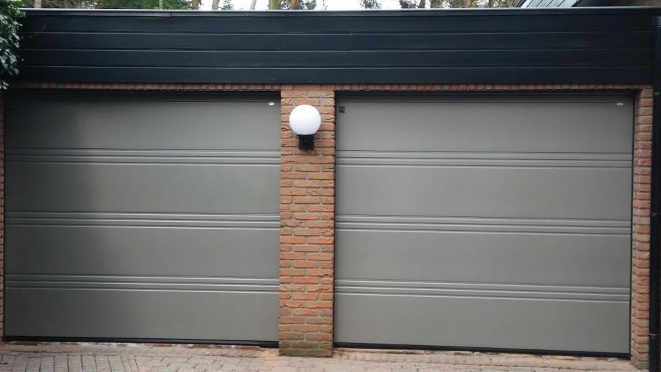 Hrmann garagedeur D profilering Silkgrain in Ral 9007