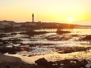 The sun is setting near the lighthouse in Doringbaai
