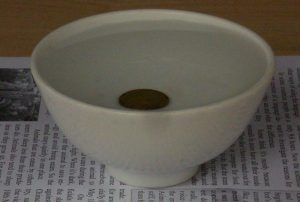 coin in the bowl - with water 2