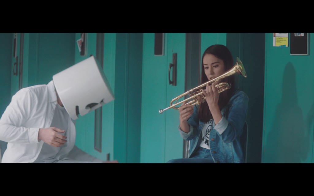 marshmello cleans the trumpet for Kayla Topp's character.