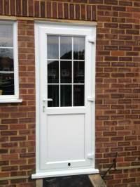 White Liniar profile uPVC back door - bevelled beading and ...