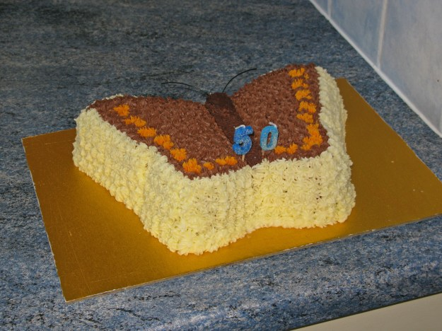 Birthday cake in the shape of a butterfly.
