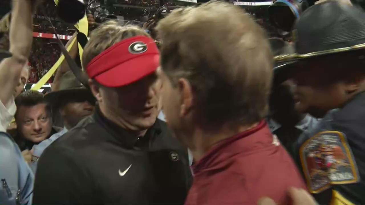 Coach Nick Saban, Kirby Smart on the field after Alabama wins SEC Championship 2018