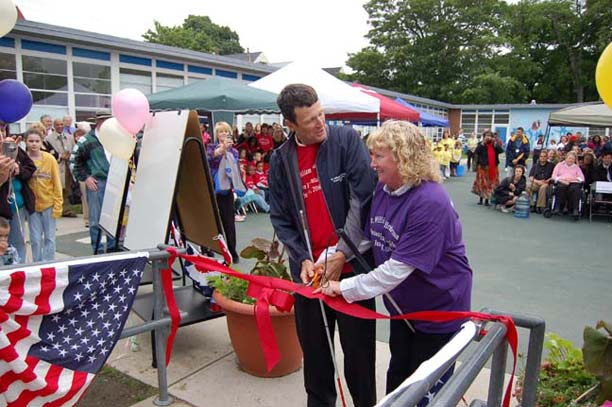 Henderson School: William Henderson, the longtime principal of the Patrick O'Hearn School, cuts a ribbon with successor Patricia Lampron during a June 23, 2009 ceremony in which city leaders announced that the school has been re-named in his honor. Photo by Filipe Miranda