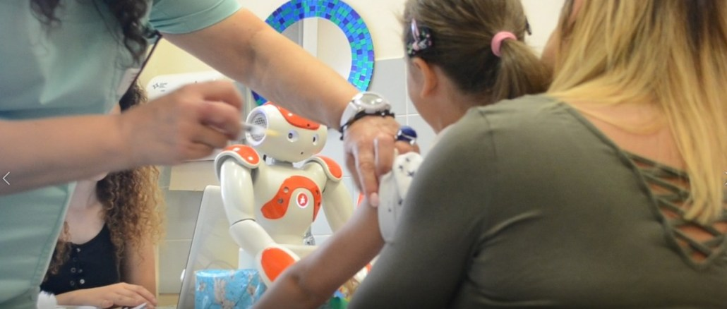 Innovativa ricerca scientifica su vaccinazione pediatrica e robot