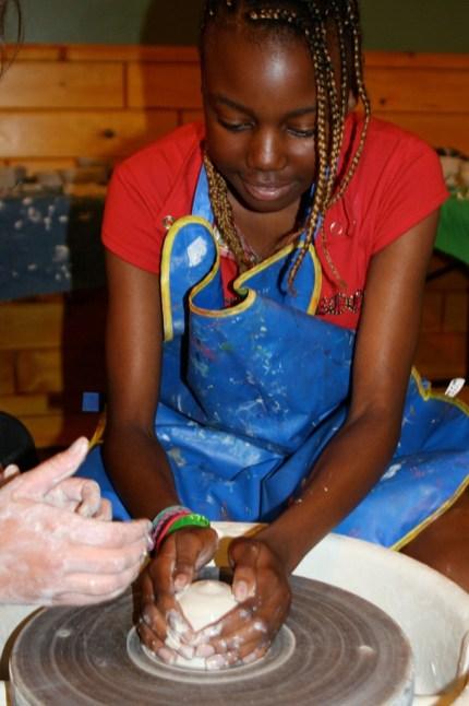camper mastering her pottery skills
