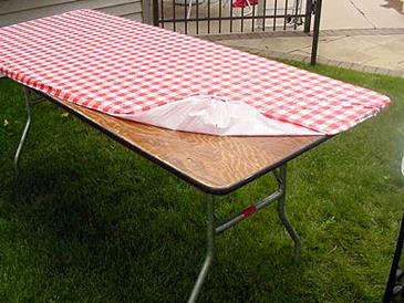 chair cover rentals langley toddler rocking personalized kwik 6ft red gingham 30x72 wa where to rent find in