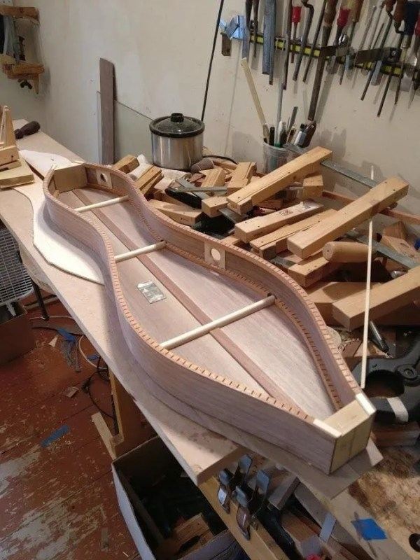 Dulcimer with sound ports in the side.