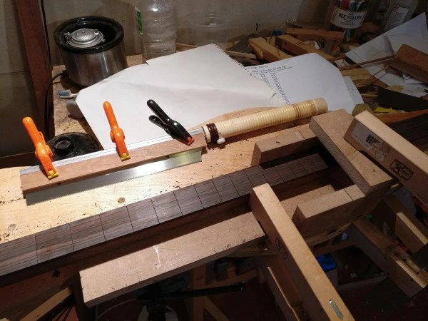 Slotting an ebony dulcimer fingerboard.