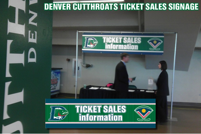 "Signage for the ""Ticket Sales Information"" booth inside the Denver Coliseum for the Denver Cutthroats home games."