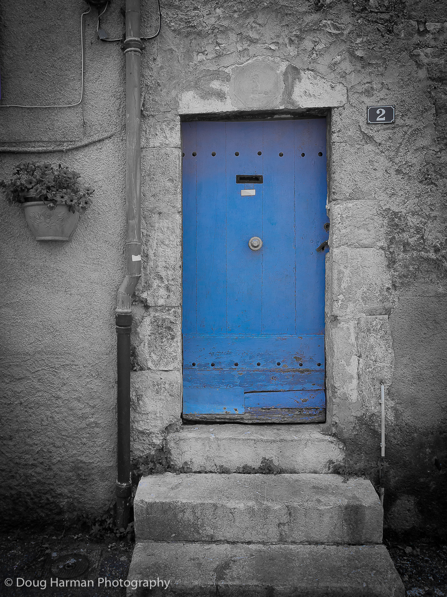 Blue doorway in France with colour pop effect.
