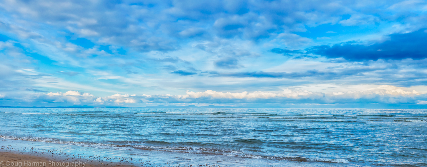 The view from Findhorn Bay beach, Scotland with the distant mountains across the Firth just visible. Photo by Doug Harman and shot using the Olympus OM-D E5 Mk II and 12-60mm F/2.8 Zuiko lens.