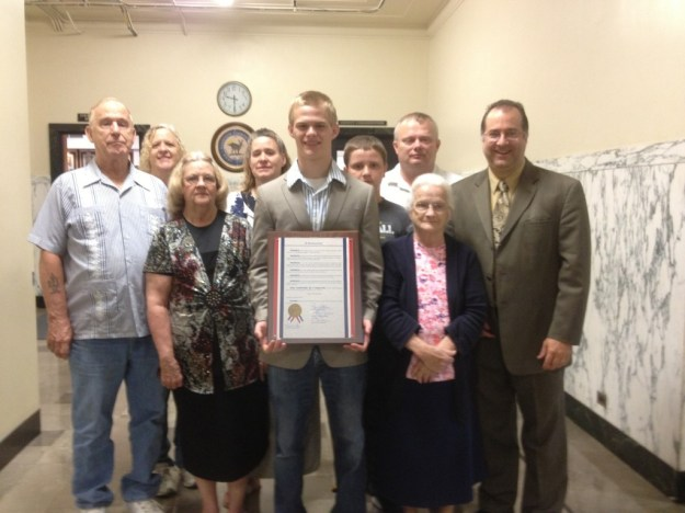 "Zach with family and his pastor (yours truly) at Harrison County Courthouse, just after receiving plaque proclaiming July 11, 2013 as ""Zach Sandy Day."""