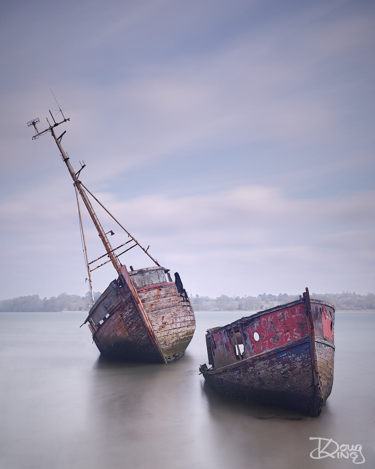 Rotting hulks of derelict boats at Pin Mill in Essex