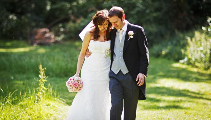 Wedding Photograph of Bride and Groom walking at Fulham Palace