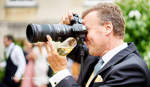 Guest with Camera at Wedding