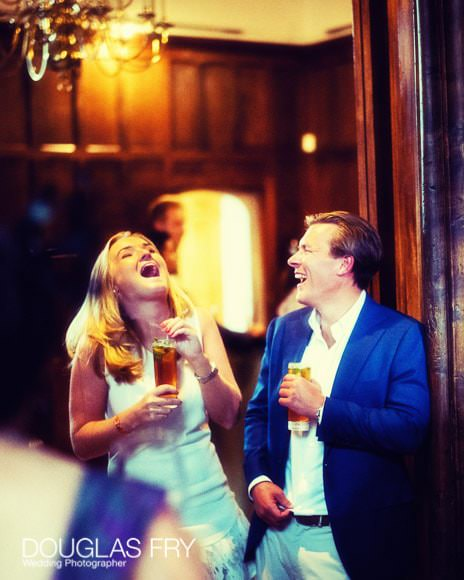 Guests Laughing at the end of the evening - wedding