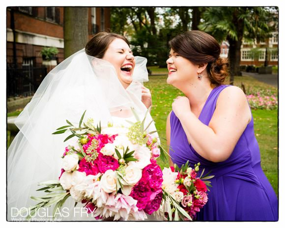 bride and bridesmaid outside London Church after wedding