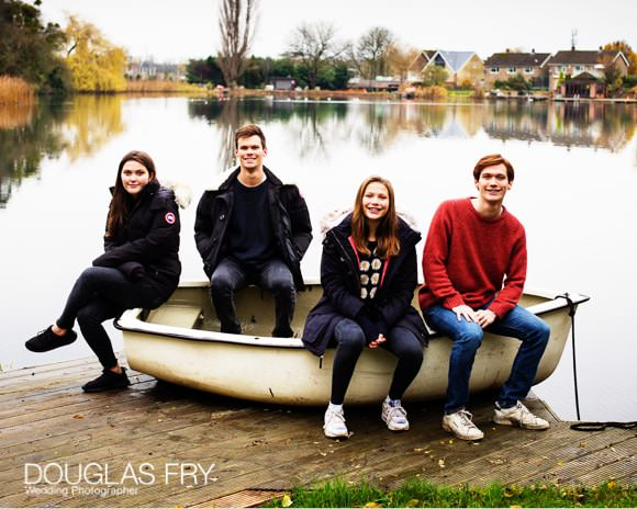 Family photographed with boat outside in Oxford