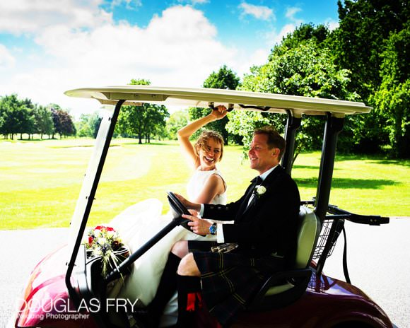 Couple in golf buggy at Richmond Golf Club