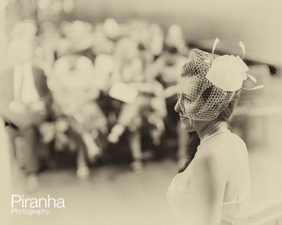 Bride photographed during wedding ceremony