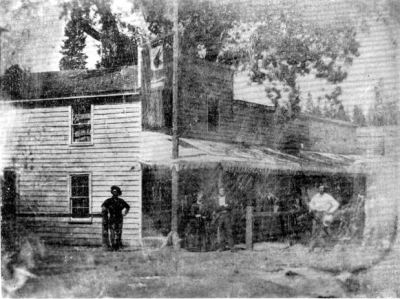 Placer Hotel - Jackass Saloon with Hanging Tree behind building.
