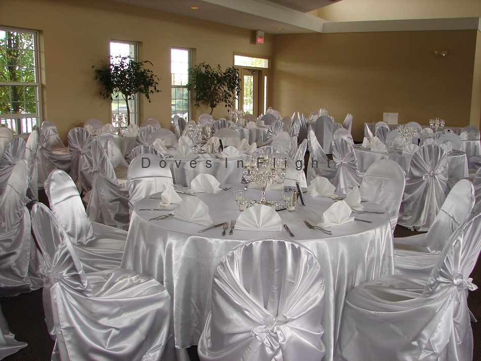 gold chair covers with black sash diy for birthday party of lansing doves in flight decorating white satin wrap