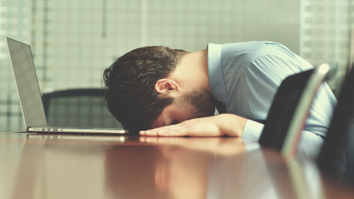 Frustrated man working on Excel Timesheet