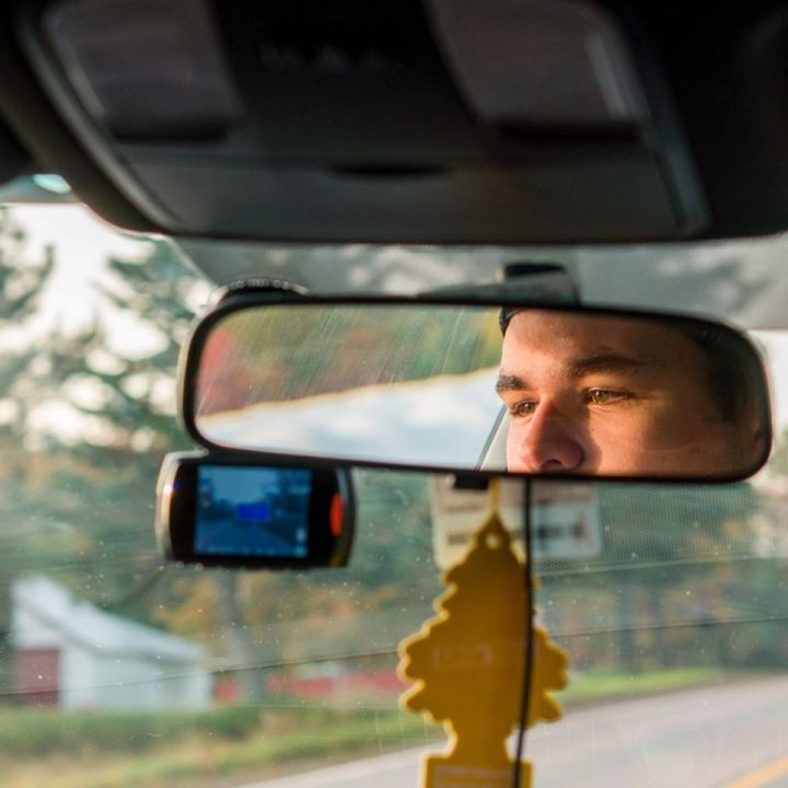 Dovico's Ryan Chitty driving with his face in the rear-view mirror.