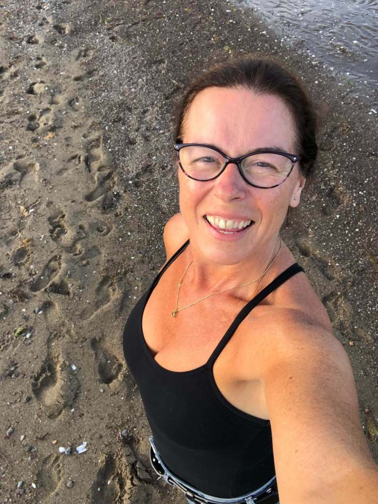 Shelley Butler in a selfie by the seashore.