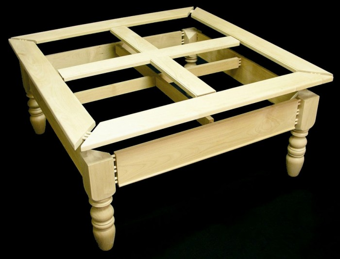 Unfinished coffee table framework assembled and dry fitted with extended pins to show joint detail.