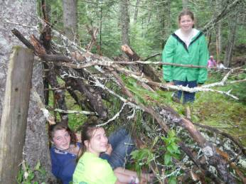 Making a shelter at Trails camp.