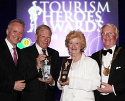 Ian Davis (second from left) receives his award with fellow winner Liz McMorris, from Down District Chairman Eddie Rea (right) and BBC Northern Ireland's Noel Thompson