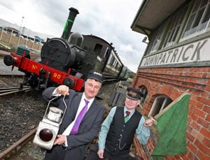 John Beaumont (left), Train Operations Manager DCDR and David Briggs (right), Carriage &Wagon Manager give the green flag for No. 90