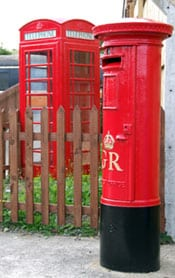 The newly repainted postbox and telephone box
