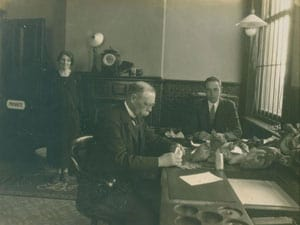 Robert Dowling (right), assistant cashier with the BCDR, with Mr. Evans, Head Cashier, and the office secretary (name unknown) in the offices in Queen's Quay Station.
