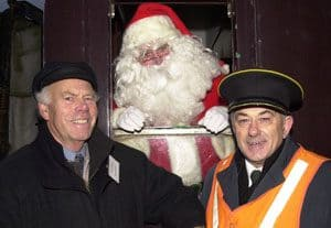Gerry Cochrane (left) with Santa Claus and Cyril Leathers on a Lapland Express train