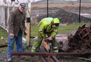 Gerry getting his hands dirty helping to cut a rail on site