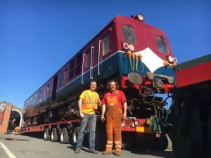 Robert Gardiner of DCDR (left) with Simon Reid, of Reid Freight Services, before power car 69 is unloaded.